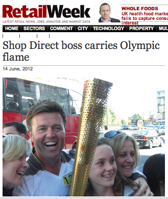Shop Direct boss Mark Newton-Jones carries the Olympic torch