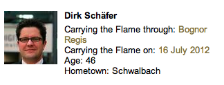Dirk Schafer carried the torch in Bognor. His image is the same as that used on a Samsung worker's LinkedIn profile.